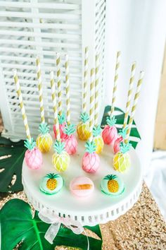Pineapple cake pops and pink and green Macaroons for a Palm Beach Glam baptism dessert station. Event styling by A Lively Affair.