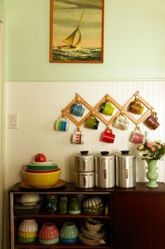 Forget the hoodies. This set-up, where a dollar-store coat rack holds coffee mugs, doubles as decor and utility — win-win. Click through for more on this and other dollar store organizers that are perfect for your kitchen.