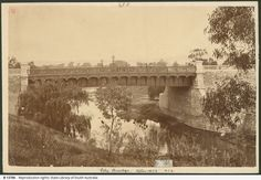 In early 1877 a new bridge was constructed over the River Torrens replacing the existing bridge connecting North and South Adelaide. The bridge was considered to state-of-the-art for its time and the first to use corrugated iron plates in the colony. Over The River, Historical Pictures, South Australia, Family History, Old Photos, Grand Canyon, Vietnam, Bridge, The Past