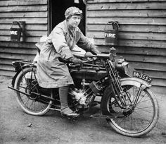 DUXFORD AIRFIELD 1918-1939 (Q 114862)   A woman dispatch rider seated on her motorbike at Duxford, c. 1919.