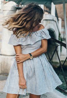 Both the vertical stripes and the off the shoulder trend is still going strong. Via Sara Escudero  Dress: The Jetset Diaries