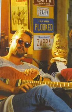 Eddie Van Halen interviewed by Dweezil Zappa for a guitar magazine, Late 90's. I absolutely love all the license plates in the back! EVH knows whats up