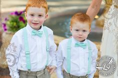 Mint green suspenders and bow ties for the ringbearers.