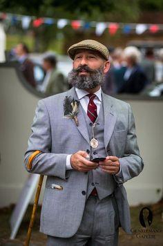 Three Piece Glencheck Suit with Tweed Cap & Cane at Goodwood Revivial (Step Back Style) English Gentleman, Gentleman Style, Moustaches, Mature Mens Fashion, Hipster Beard, Goodwood Revival, 3 Piece Suits, Suit And Tie, Well Dressed Men
