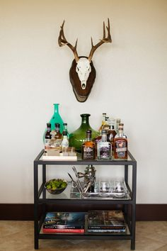 A bar cart decorated with finds from Trove Market. Follow Trove Market to get best tips on decorating with vintage second hand finds. Or download our app to check out amazing treasures. #bar #barcart #styling #situate | Trove Market