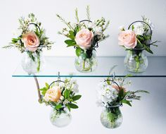little floral aisle markers ion peach roses and white stock