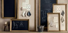 Oversized chalkboard and linen pin board next to each other on the wall in the breakfast room? Perfect place for kids' weekly artwork and schedules