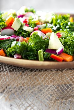 """""""massaged"""" kale salad:  1 tbsp oil (I love flax, hemp, or avocado oil for dressings) + 2 tbsp fresh lemon juice + 1 tsp pure maple syrup. Massage into the kale leaves. Let this """"marinate"""" while you prep the vegetables."""