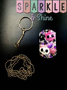 """Add a bit of adorable goth glam to your keys with these cute grape colored skullies!   Dog tags are available on a 30"""" ball chain necklace, or on a keychain.   Unless otherwise pictured all dog tags have a fully blinged back.  (Any overcharges for shipping will be refunded once your order i..."""