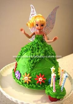 Homemade Tinkerbell Birthday Cake: My daughter wanted a Tinkerbell Birthday Cake for her 4th birthday so after finding this site I was inspired to have a go at a Dolly Varden Cake.  I bought
