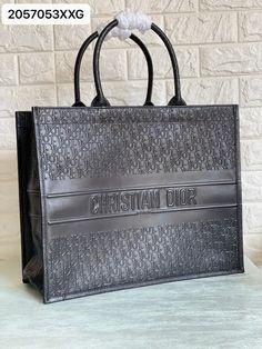Christian Dior embossed leather book tote bag black Dior Bags, Leather Books, Black Tote Bag, Christian Dior, Chanel, Fashion, Dior Handbags, Moda, Fashion Styles