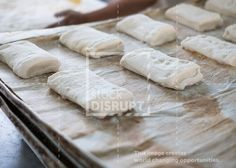 Ciabatta bread loafs on a baker's tray - Part of stockdisrupt.com 's Bakery Bundle. 100+ Bakery 4K videos, photos, graphics, print template etc... for only 19.99 and 100% of money goes to forming an amazing cause.