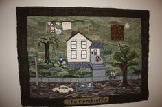 A hooked rug of my home growing up.  All 5 of us kids my mom and dad.  It is hooked using clothes from my dad and my mom.  A true labour of love.