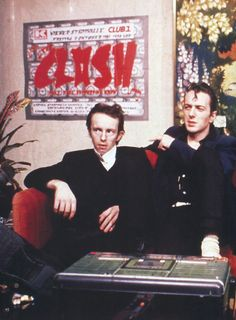 """Topper Headon and Joe Strummer, 1981 (Vienna airport) """" Shut up will ya, you stupid cunt. - Oh, thanks very much. Yeah, that's what you deserve with that sort of crap. What do you think we are, do you think this is..."""