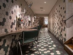 Gourmet Burger Kitchen in Clapham features hexagon shaped tiles on both the floor and on the walls. Solus Ceramics supplied tiles from the versatile Program range in a variety of colours. The hexagon tiles were skilfully laid in an irregular formation.