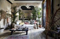 designer Sera Hersham-Loftus. All in all eclectic. Dark blue ceiling, light creme walls with white borders.