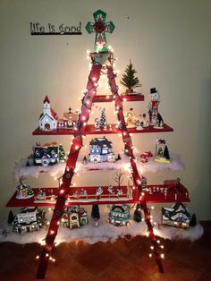 Old wooden ladder snow village. Found the ladder at the swap meet! Added 3 boards, painted red and added lights. ❤️