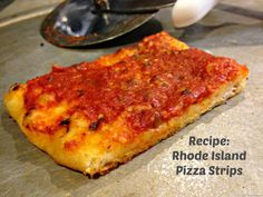 If you've visited Rhode Island, you've hopefully had a pizza strip. It's crunchy and chewy pizza that is topped with red sauce and sometimes grated cheese. Cheese Dishes, Cheese Recipes, Pizza Recipes, Cooking Recipes, Cheese Bread, Pasta Side Dishes, Pasta Sides, Main Dishes, Rhode Island Pizza Strips Recipe