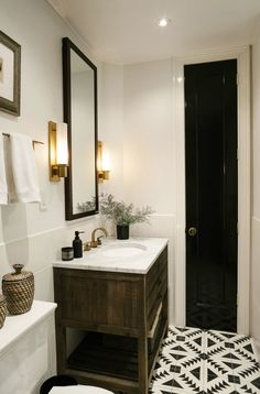 Bathroom - natural oak and walnut, black and white tiled floor