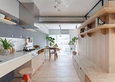 Sinato hides bedrooms behind an L-shaped wall in Fujigaoka M apartment