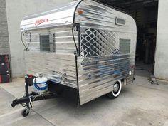 Joe Sebregandios' beautiful restoration of a 1964? - 8' box Friendship Fireball travel trailer. Stunning renovation.