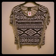 ??Tribal Fringe Crop Top?? 100% rayon crop top with a black and white tribal print and fringe along both sides of the top. Never been worn. Rue 21 Tops Crop Tops