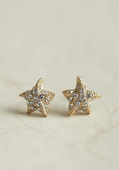 Sparkling Shore Starfish Earrings 9.99 at shopruche.com. These delightful gold-toned starfish earrings are adorned with glistening rhinestones for a hint of shimmer.Approx. 0.5