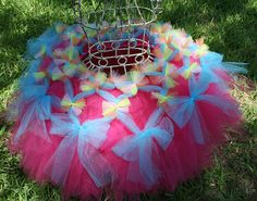 Party tutu. This is only a picture of the tutu, but it gives a very good visual idea of how to make it & I know a little girl who would love this.