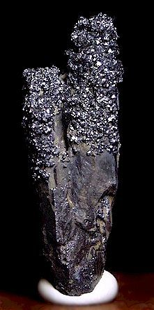 Terminated elongated Pyrargyrite crystal cluster, Micro-crystals of Pyrargyrite accent the upper portions of both terminations. This exceptional specimen is from Guanajuato, Durango, Mexico. Measures 5.5 cm in length, Ex. F. J. Barlow Collection.