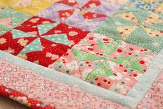 busy little pinwheel quilt by nanaCompany, via Flickr