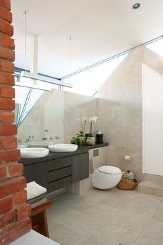 Il Bagno Alessi sink and toilet in master bathroom