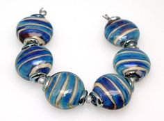 Blue and ivory 21mm button lampwork glass beads by Pearlykarpel