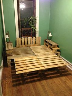 king size bed frame made from pallets | ... bed sheets multiple sized pillows and glimmering lights around the bed