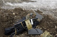 Dug in: a member of the Ukrainian forces sleeps out in the open, at his position not far from the embattled town of Debaltseve.