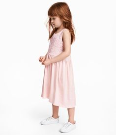 Light pink. Sleeveless dress in soft slub cotton jersey. Bodice with lace-covered front section. Seam at waist and gathered skirt. Slightly longer at back.