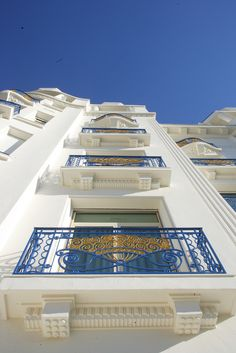 View from below on the White facade and Window blue and gold fan style ramps at the Hotel Martinez Cannes, France