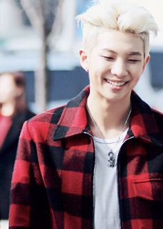 Rap monster Kim NAMJOON bts bangtan boys leader airport fashion red and black jacket blonde hair