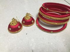 Gold and beautiful red combination bangles and earrings made with silk thread