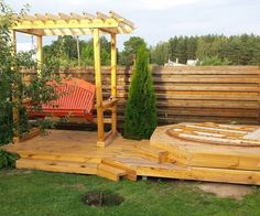 7-in-1 summer squeeze: hot tub, deck, swings, arbor, firepit, birdhouse, hammock swing
