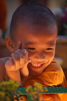 Smile for me!! Beautiful young monk photograph