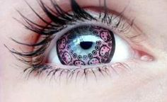 """Called """"Hello Kitty Violet,"""" these contact lenses are a light purple with illustrations of Hello Kitty's demure face and heart marks encircling the pupil"""