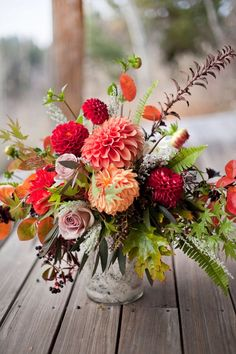 "Wedding Flower Arrangements Stunning fall floral arrangement with dahlias, roses and ferns. - Inspired by the Norah Jones song ""Come Away With Me,"" this beautifully styled fall wedding shoot inspires a romantic escape to the mountains. Fall Floral Arrangements, Beautiful Flower Arrangements, Wedding Flower Arrangements, Floral Centerpieces, Centerpiece Wedding, Tall Centerpiece, Homemade Wedding Centerpieces, Dahlia Centerpiece, Centerpiece Ideas"