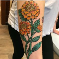 Lovely calendula tattoo by Daniel Dozier. #primaldecor #safetattoo #tattooedandgorgeous #tattooedandproud #calendula #flowertattoo #licensedtattooartist #707tattoos #707ink #waverlyink #workhorseirons #blackclawtattoo