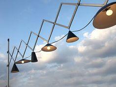 Outdoor lighting system by Iris Design Studio.