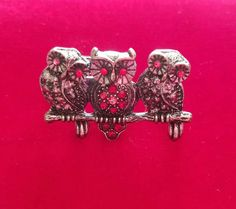 Check out this item in my Etsy shop https://www.etsy.com/listing/524779087/vintage-3-owls-together-adjustable-ring