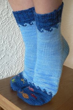Fish in the Sea is a whimsical sock design sized for both children and adults. The detailed pattern includes instructions and charts for the fair-isle waves and the duplicate-stitch fish.