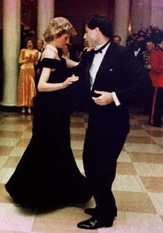 Diana dancing with John Travolta at a 1985 White House State Dinner.