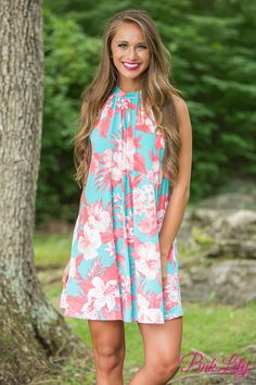 This vibrant halter top dress will stand out at all of your summer events! It features a bold floral print in aqua, white, and orange for a stunning pop of color. The fabric is silky soft and breathable - making it cool and comfortable on even the warmest days of summer!