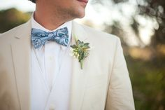 Great suit, vest, shirt and bow-tie combo! (And love that succulent boutinere)