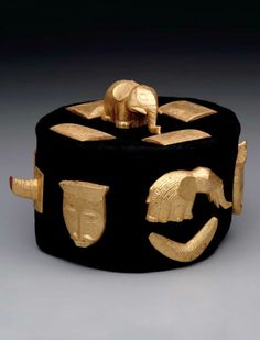 Africa | Crown from the Baule people of Ivory Coast | Wood covered with gold leaf, and textile | c. 1920